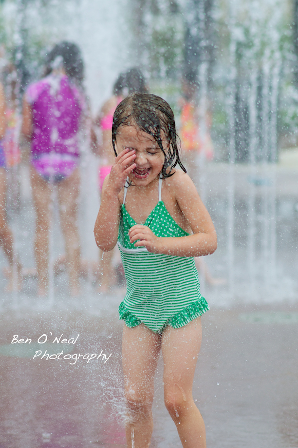 Wet Little Girl | Cute Little Girl Plays in Coppell, Texas Splash Park | Dallas, Texas Lifestyle Photographer